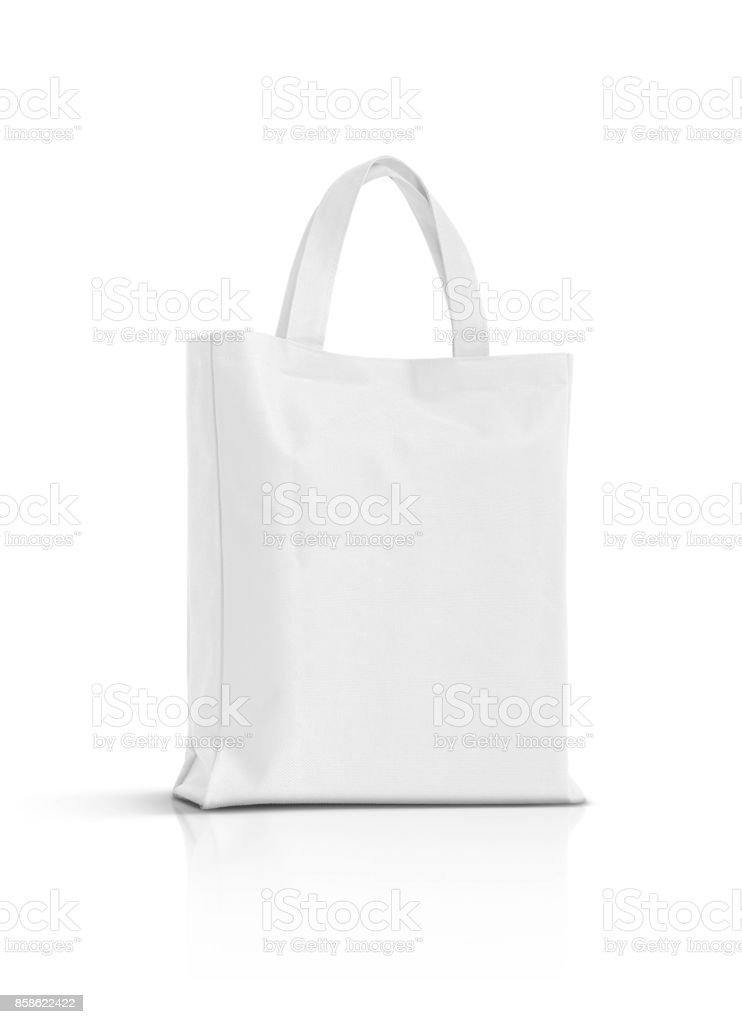 blanco en blanco de la tela de la lona bolsa para compras aisladas sobre fondo blanco - foto de stock