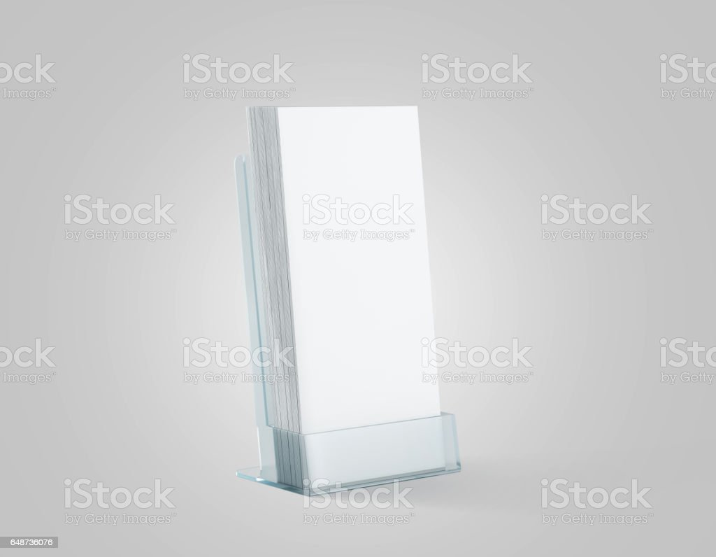 Blank white flyers stack mockup in glass plastic holder stock photo