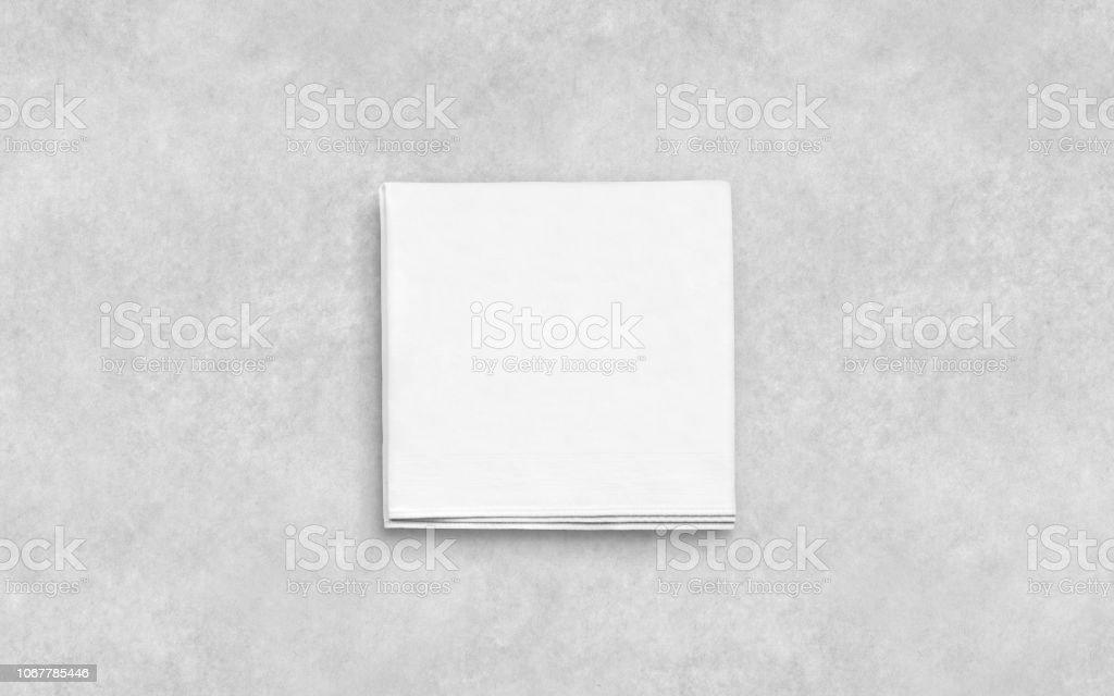 Leere weiße gefaltete Serviette auf strukturierte Oberfläche mockup – Foto