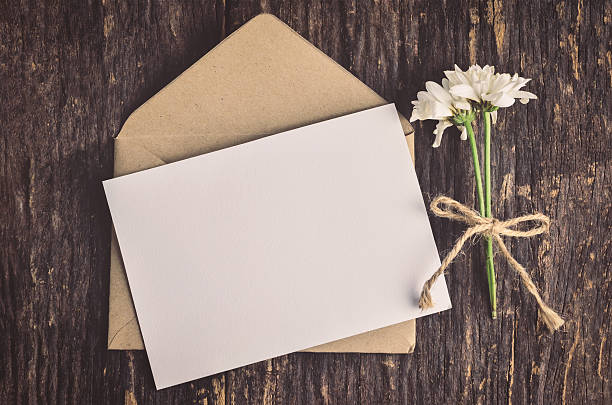 Blank white greeting card with brown envelope stock photo