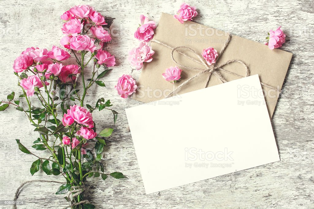 Blank White Greeting Card With Pink Rose Flowers Mock Up