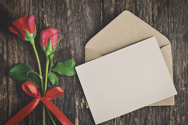 Blank white greeting card with red rose stock photo