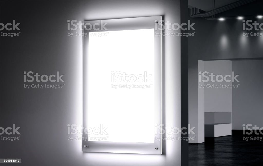 Blank white illuminated poster mock up in dark hall stock photo