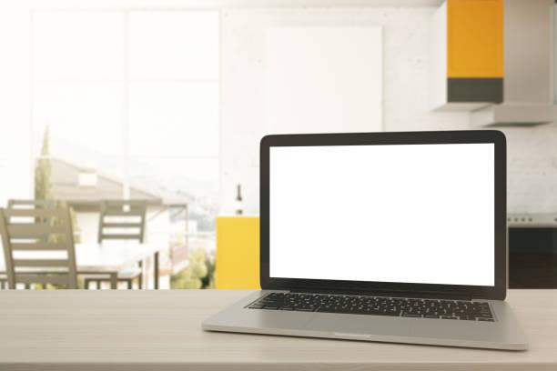 Blank white laptop in kitchen stock photo