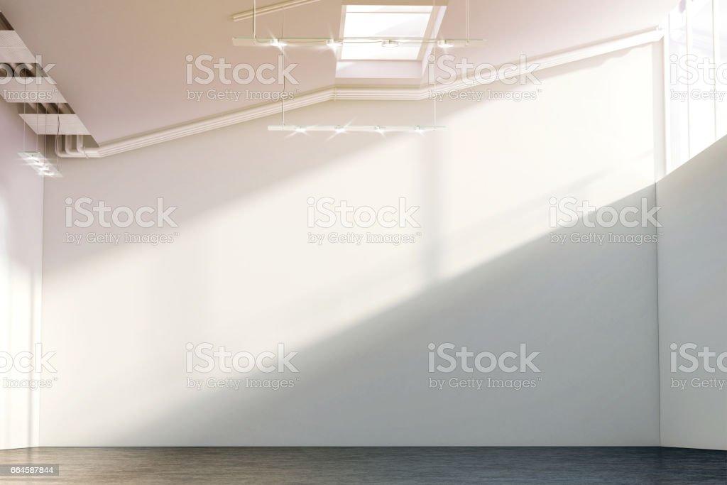 Blank white large wall mockup in sunny modern hangar hall stock photo