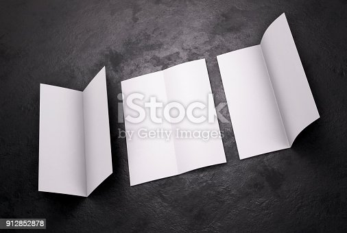 1141440440 istock photo Blank white leaflet Mockup on black, booklet. 3d rendering 912852878