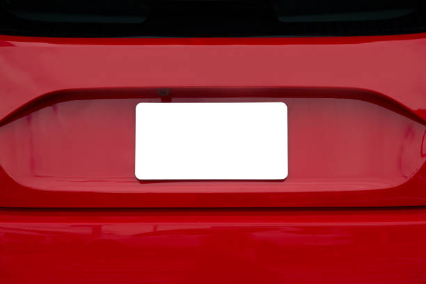 Blank White License Plate On Back of Red Car Horizontal shot of a blank white license plate on the back of red car. bumper stock pictures, royalty-free photos & images