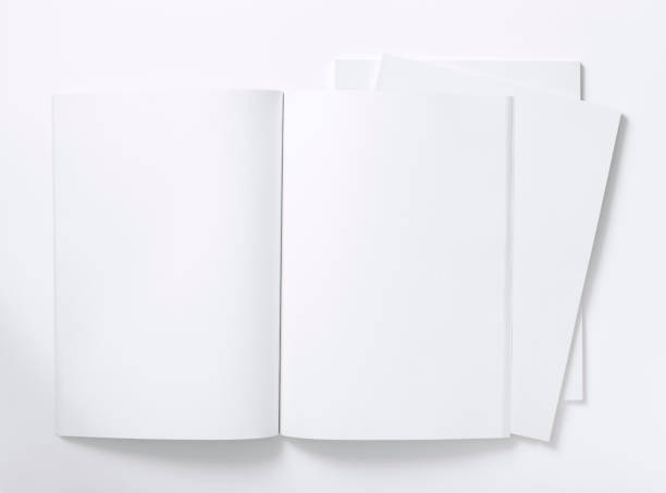 blank white magazine lying open on a white table - catalogue stock photos and pictures