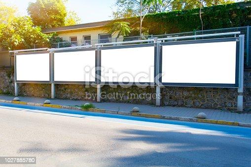 istock Blank white mockup four billboard in empty Istanbul street 1027885780