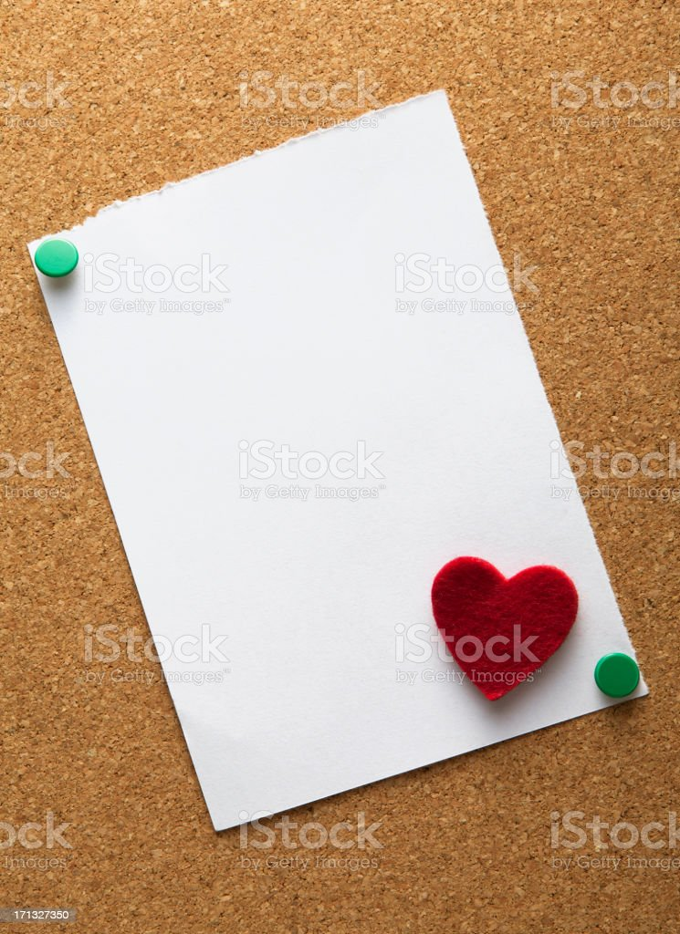 blank white note paper on cork board royalty-free stock photo