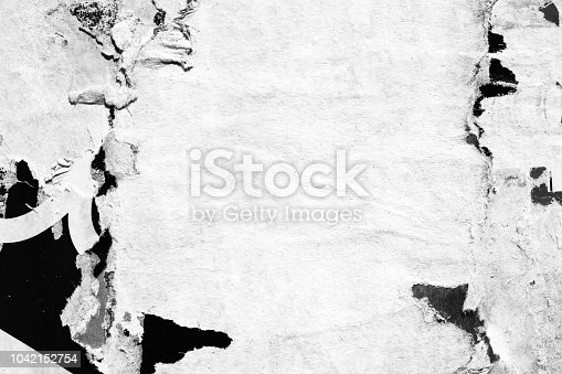962578882 istock photo Blank white old ripped torn paper crumpled creased posters grunge textures backdrop backgrounds 1042152754