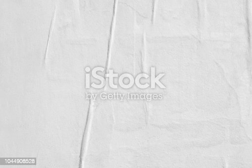 1087065964 istock photo Blank white old ripped torn paper crumpled creased posters grunge textures backdrop backgrounds placard 1044908528