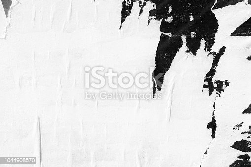 1087065964 istock photo Blank white old ripped torn paper crumpled creased posters grunge textures backdrop backgrounds placard 1044908570