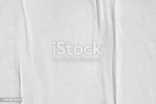 1087065964 istock photo Blank white old ripped torn paper crumpled creased posters grunge textures backdrop backgrounds placard 1044913452