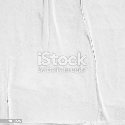 1087065964 istock photo Blank white old ripped torn paper crumpled creased posters grunge textures backdrop backgrounds placard 1044915630