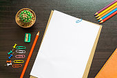 istock Blank white paper and colored pencil on the desk. 621843818