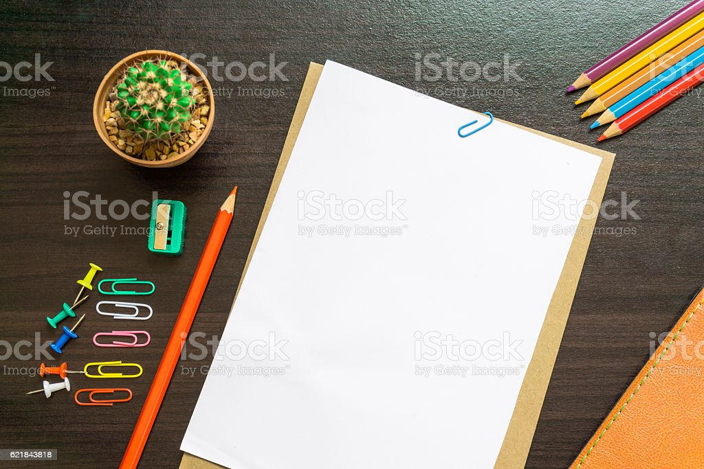 Blank white paper and colored pencil on the desk. stock photo