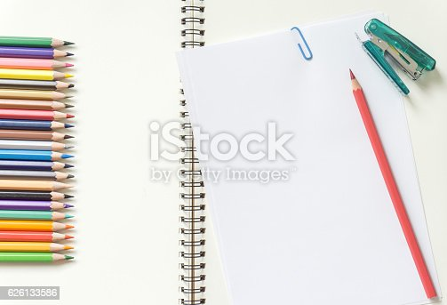 621843818istockphoto Blank white paper and colored pencil on the desk. 626133586