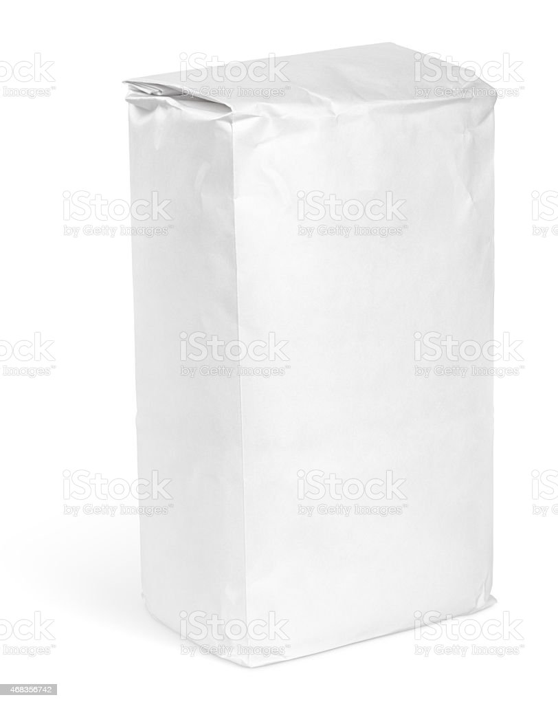 Blank white paper bag filled with flour isolated on white stock photo