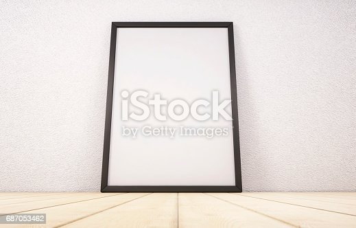 istock Blank white paper poster in black frame standing on wooden floor. Mock-up template for your design. 3d rendering 687053462