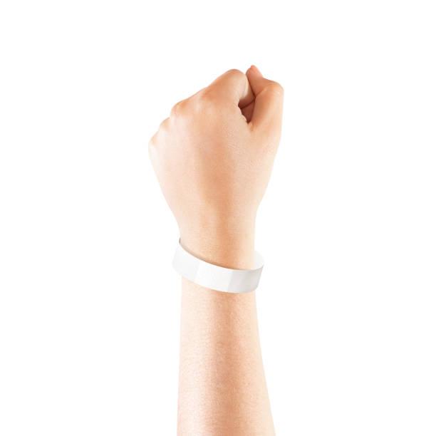 blank white paper wristband mock up on persons arm - браслет стоковые фото и изображения