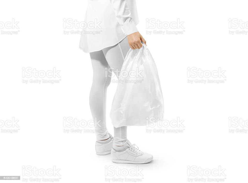 Blank white plastic bag mockup holding hand stock photo