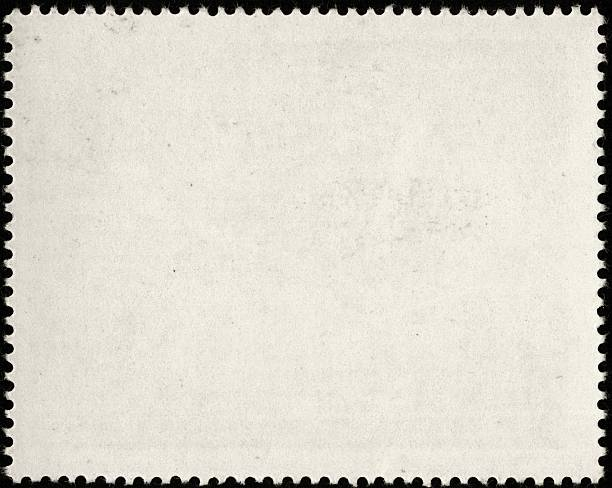 Blank white postage stamp with serrated edges stock photo