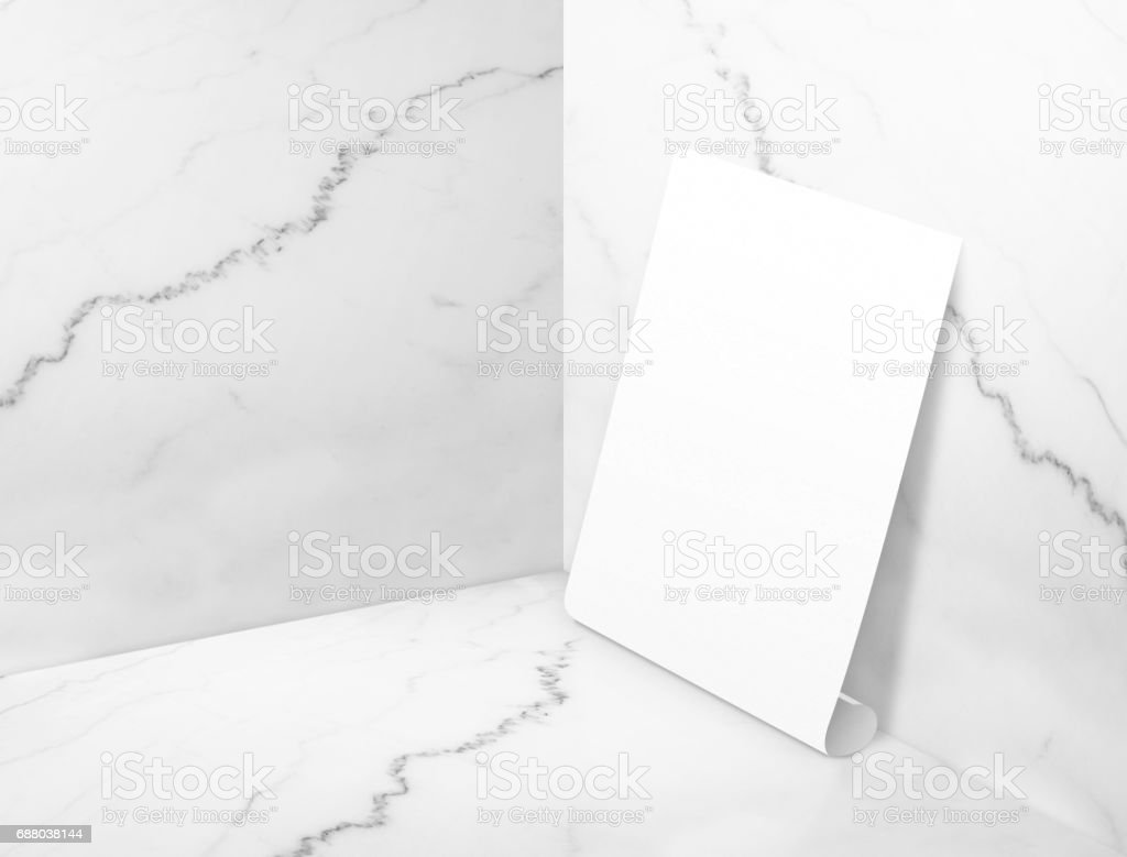 Blank white poster at white glossy marble corner studio room background