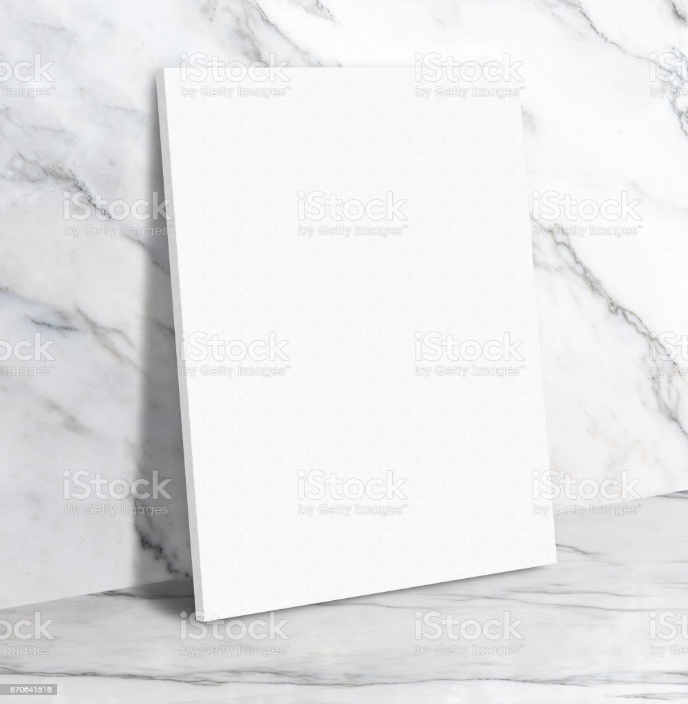 Blank White Poster Canvas In White Glossy Marble Floor