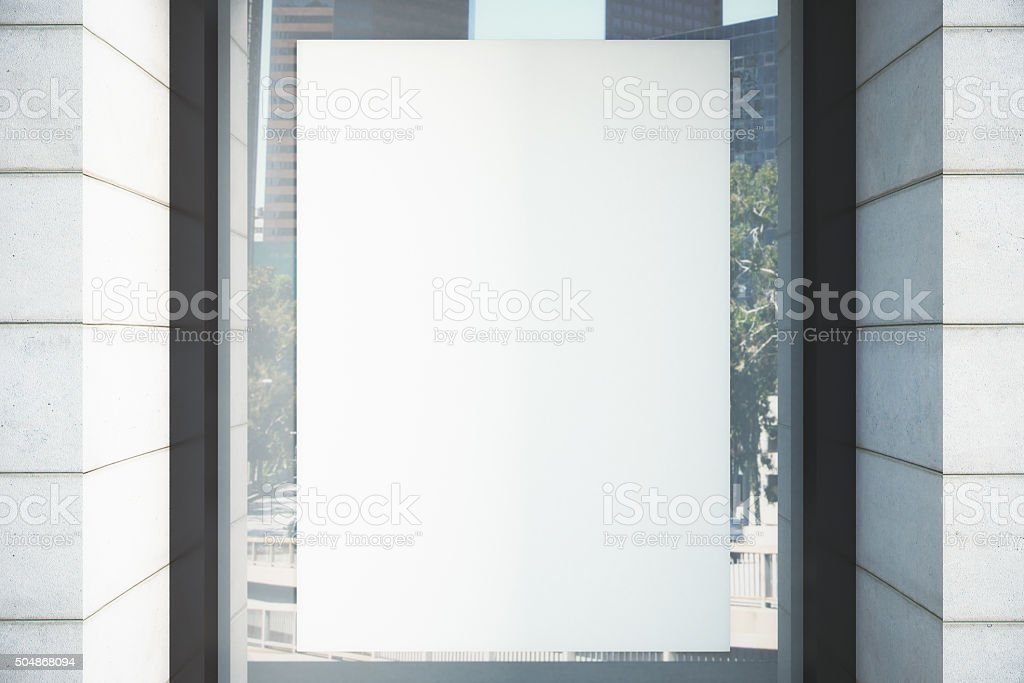 Blank white poster on the window, mock up stock photo