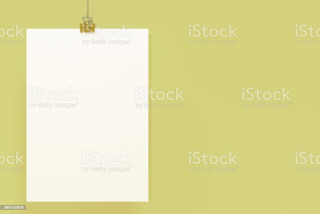 Blank white poster with binder clip mockup on yellow background royalty-free stock photo