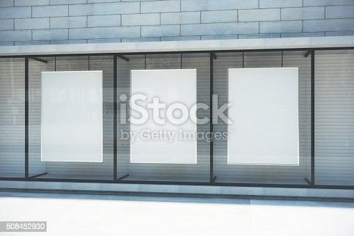 istock Blank white posters in glassy showcase on the street 508452930