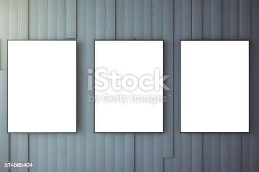 518847146istockphoto Blank white posters on grey wall, mock up 514565404