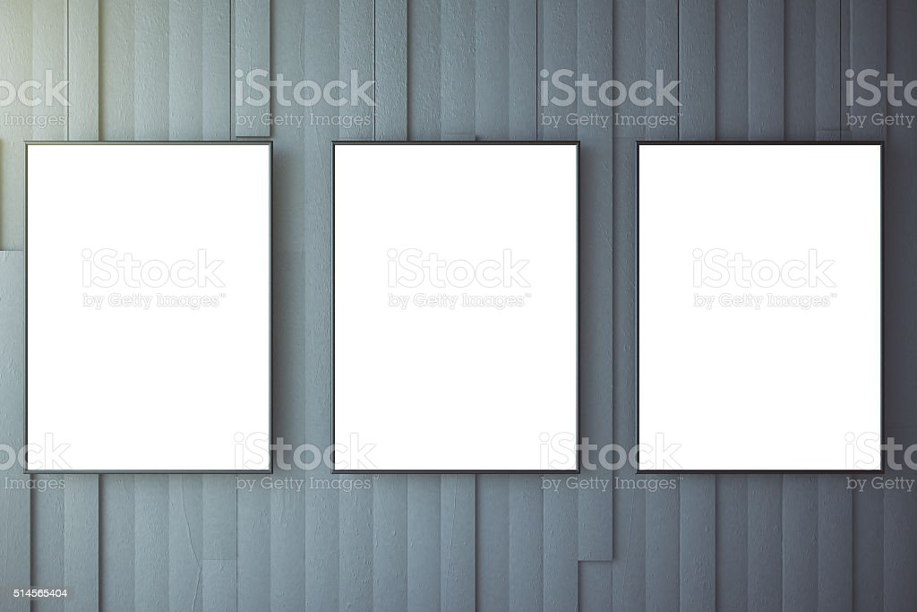 Blank white posters on grey wall, mock up stock photo