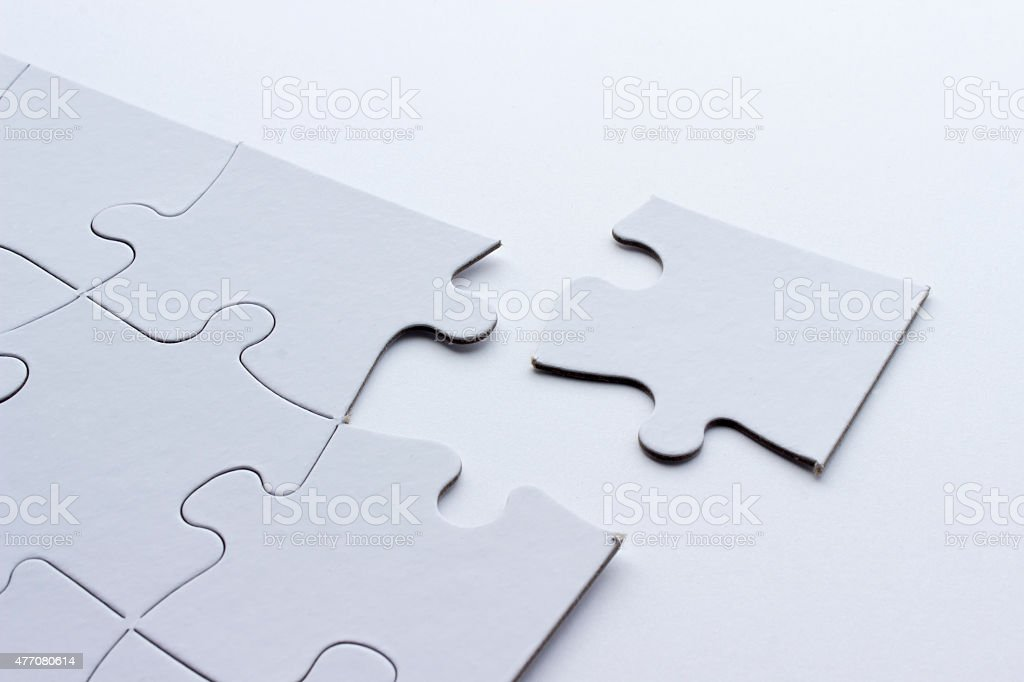 Blank White Puzzle With Missing Piece stock photo