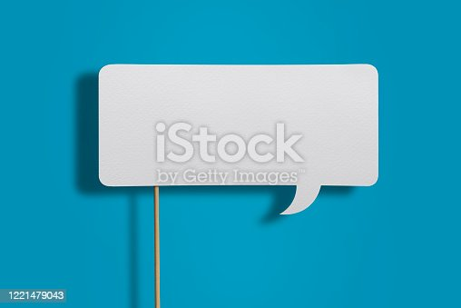 Blank White, rectangular Chat Bubble, Speech Balloon With Wooden Sticks On Blue Background With Clipping Path.