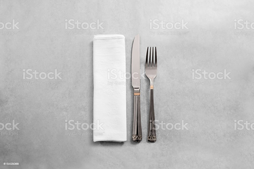 Blank white restaurant napkin mock up with fork and knife, – Foto