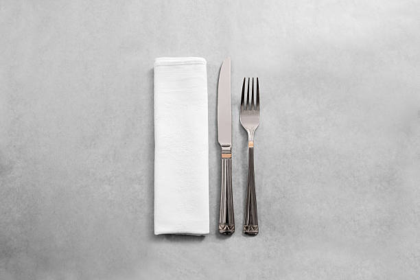 Blank white restaurant napkin mock up with fork and knife, stock photo