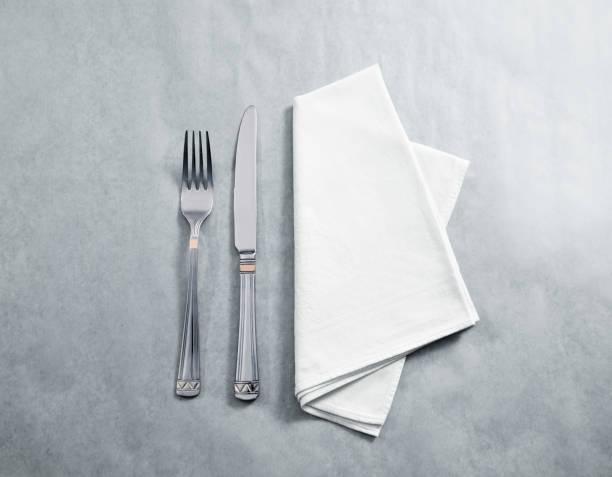 blank white restaurant napkin mockup with knife and fork - servett bildbanksfoton och bilder