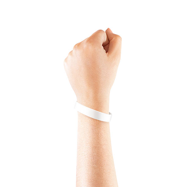 Blank white rubber wristband mockup on hand, isolated Blank white rubber wristband mockup on hand, isolated. Clear sweat band mock up design. Sport sweatband template wear on wrist arm. Silicone fashion round social bracelet wear on hand. Unity band. wristband stock pictures, royalty-free photos & images