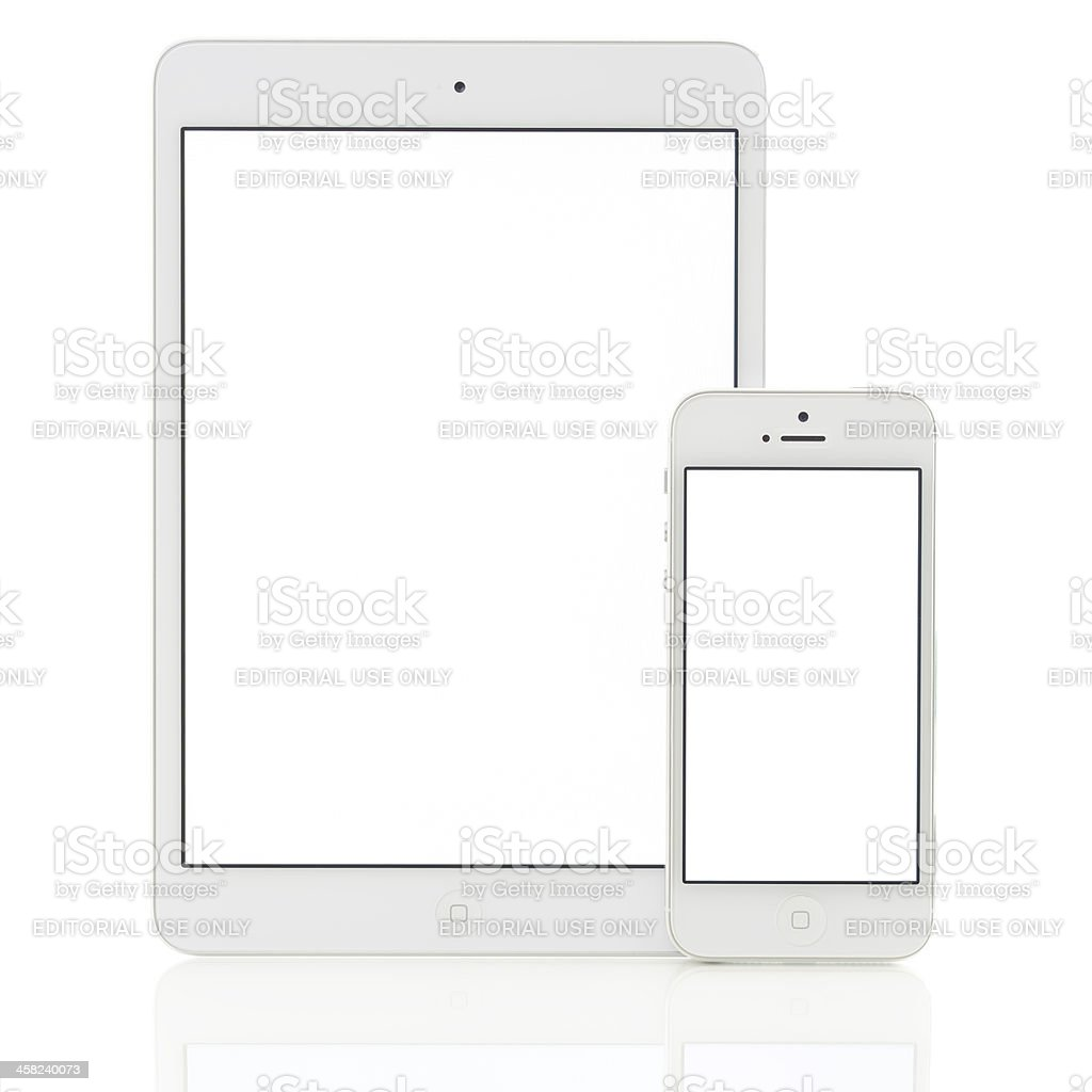 Blank white screen iPad Mini & iPhone 5 stock photo
