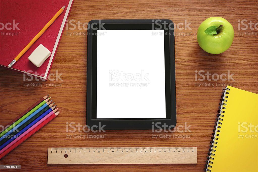 Blank white screen tablet pc at student desk stock photo