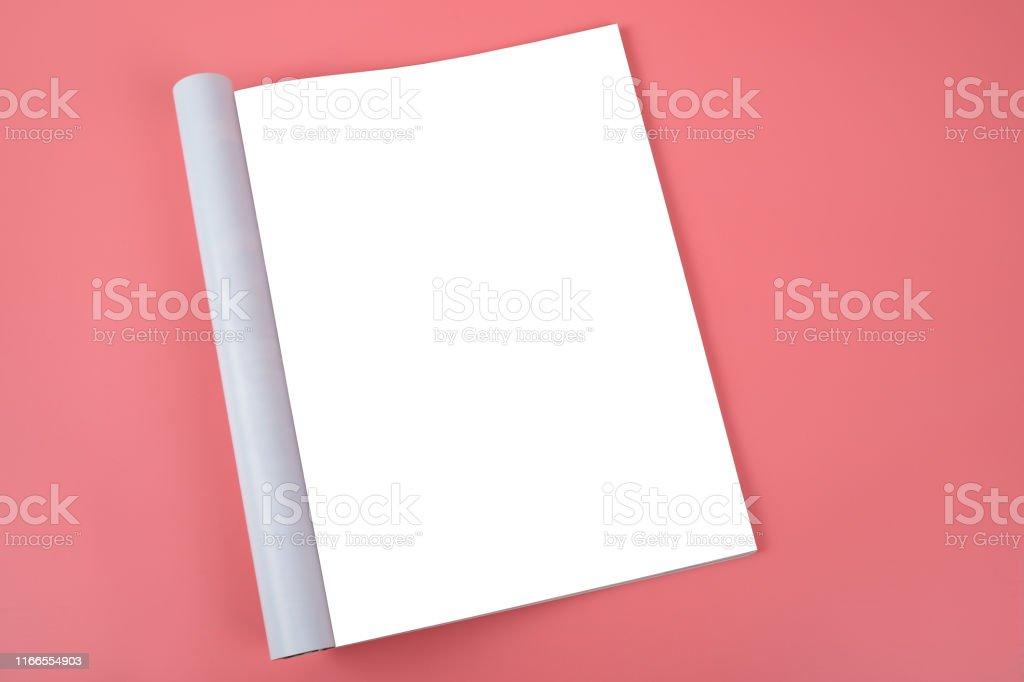 Blank white sheet of a magazine on a pink background, glamor. Mock up...