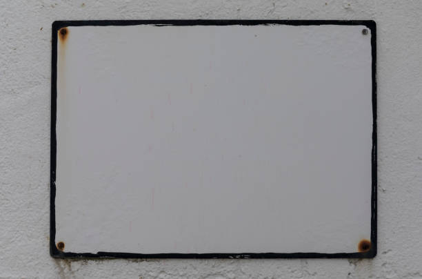 Blank white sign on white wall stock photo