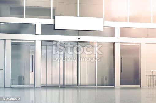 Blank white signage on the store glass doors entrance mockup, 3d rendering. Commercial building automatic entry, banner mock up. Closed transparent business centre facade, front view.