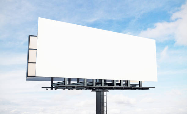 Blank white sky billboard Blank white billboard on blue sky and clouds background. Commercial and ad concept. Mock up, 3D Rendering billboard stock pictures, royalty-free photos & images