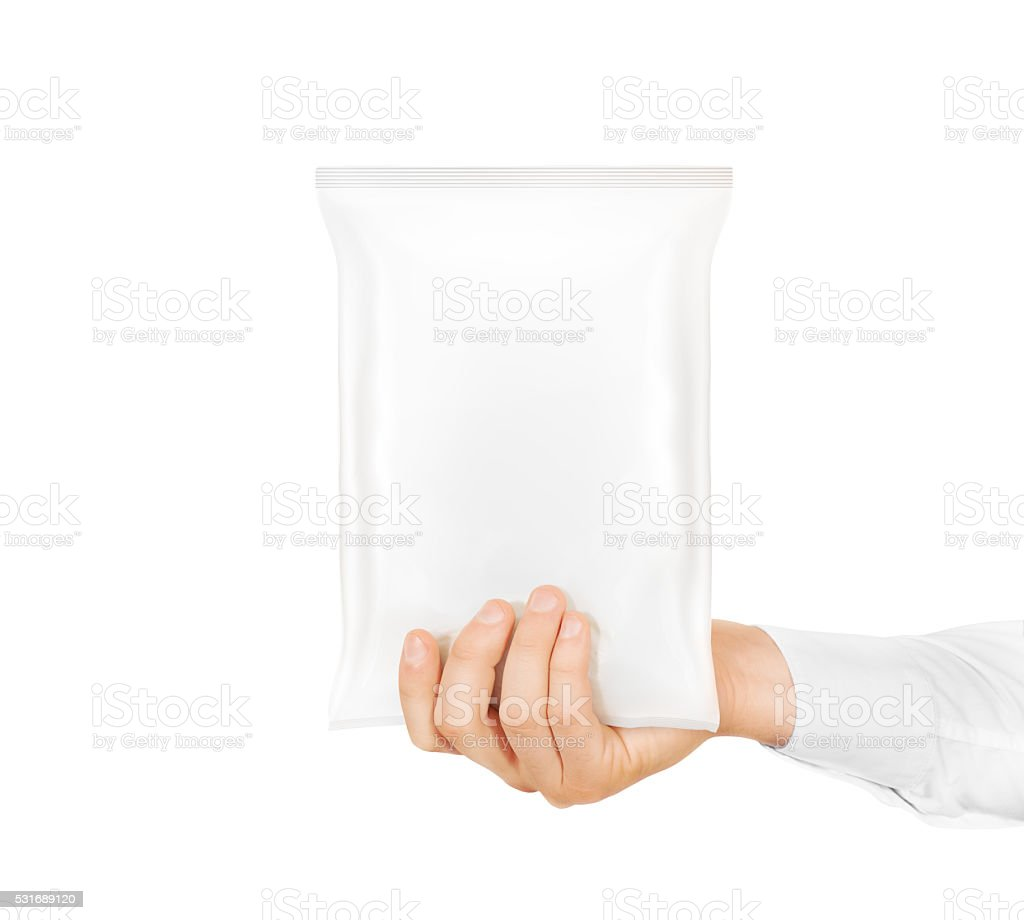 Blank white snack bag mock up hold in hand isolated stock photo