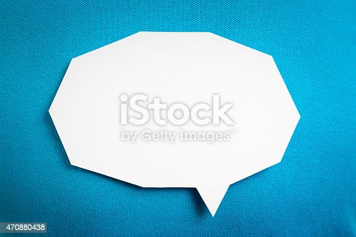 istock Blank white speech bubble, conversation on blue background textured. 470880438