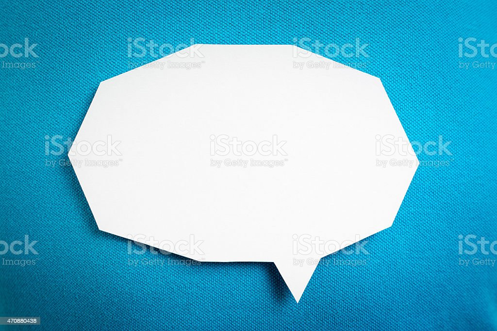 Blank white speech bubble, conversation on blue background textured. stock photo