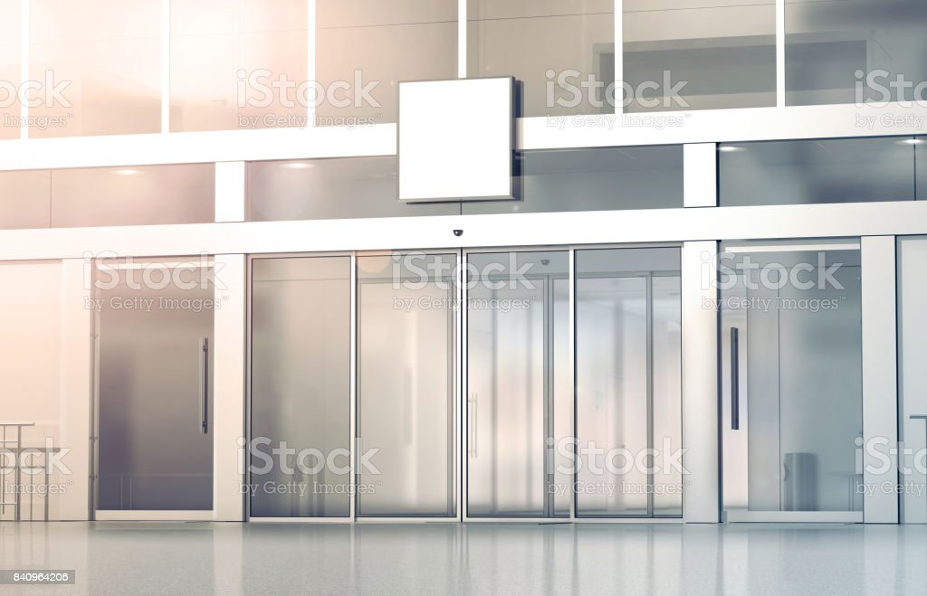 Blank white square signage mockup on store glass sliding doors stock photo